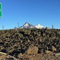 North (10,085') and Middle Sister (10,047') across the lava flows at the summit pass.- McKenzie Pass Scenic Byway