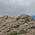 Summit scramble at 11,300 feet.- Twin Sisters Peak Hike