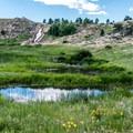Dam spillway waterfall and ponds below the lake.- North Crow Reservoir Loop