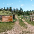 The trail begins at the horse corrals.- Lariat Trail + Stone Temple Circuit