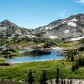 Lewis Lake with Sugarloaf and Medicine Bow peaks.- Shelf Lakes Hike via Gap Lakes Trail