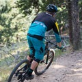 A rider cruising the trails on a sunny afternoon.- Evergreen Mountain Loop