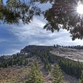 As you begin the hike the south rim of Big Cottonwood looms overhead.- Lake Blanche Trail