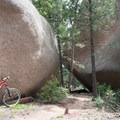 Two house-sized boulders you get to squeeze through on the trail.- Little Scraggy Mountain Bike Ride
