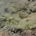Steam emerging from the kaolinite clay and silica remains.- Bumpass Hell