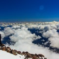 A climber takes in the view above the clouds.- Mount Shasta: Clear Creek Route