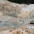 The boardwalk allows close views of the fumuroles and boiling pools.- Bumpass Hell