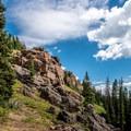Rocky outcrops appear near the summit.- Rabbit Ears Peak
