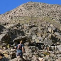 A hiker climbs the north ridge toward the false summit.- Mount of the Holy Cross, North Ridge Route