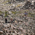 Hikers make their way up the ridge over the rocks.- Mount of the Holy Cross, North Ridge Route