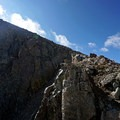 A hiker makes his way down the final pitch of the climb.- Mount of the Holy Cross, North Ridge Route