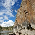 A cliff jumper jumps into the Colorado River from 45 feet above.- Radium Hot Springs