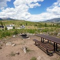 Each campsite features a picnic table and fire pit. - Lowry Campground
