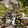 A small waterfall in the high alpine.- Ring Lake Trail