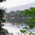 A few kayakers taking advantage of the glassy water. - Sasamat Lake