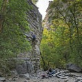 A couple and their dog enjoying the climbing available in the canyon.- Ferguson Canyon Trail Hike
