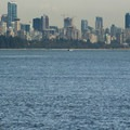 The view of Vancouver's skyline from Eagle Point.- Lighthouse Park