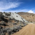 Mine tailings piles and shafts are visible throughout the trail.- Comstock Mining Loop