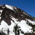 Snow lingers in the mountains through spring and early summer.- Crater Lake, Wallowas