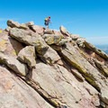 Scrambling along the summit spine near the climb's finish.- First Flatiron