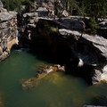 Cliff jumpers at Devils Punchbowl.- Devils Punchbowl Swimming Hole