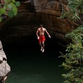 A man jumps into Devils Punchbowl.- Devils Punchbowl Swimming Hole