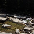 Large boulders allow for crossing the Roaring Fork River. - Devils Punchbowl Swimming Hole
