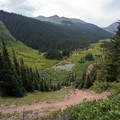 Hiking down into Fravert Basin. - Four Pass Loop