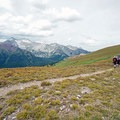 Backpackers begin their descent off of Buckskin Pass.- Four Pass Loop