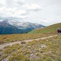 Backpackers begin their descent off of Buckskin Pass.- Four Pass Loop