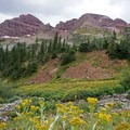 The trail follows the Maroon Bells into Minnehaha Gulch. - Four Pass Loop