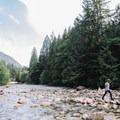 Rock hopping across the creek. - Gold Creek Falls, Lower Falls Trail
