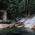 Some swim in the pool at the top when the water is low. - Gold Creek Falls, Lower Falls Trail