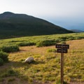 From the parking lot, start out across the green basin toward the mountain.- Mount Bierstadt, West Slopes Route