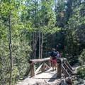 Crossing Glacier Creek.- The Loch Hike