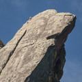 View of the Third Flatiron with climbers summiting.- Royal Arch Hike