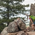 Viewing scope along the Fowler Trail for spotting climbers and raptors.- Eldorado Canyon State Park