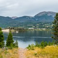 Lake Dillon is just a short walk from most sites.- Peak One Campground