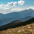 Just a short walk past the rocks, the view down to Beaver Meadows with Flattop Mountain in the distance.- Ute Trail Hike to Timberline Pass