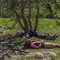 JMT hikers resting in the shade at Wallace Creek Camp.- John Muir Trail Section 4