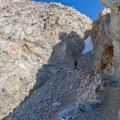 A JMT hiker decending Forester Pass.- John Muir Trail Section 4