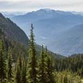 Looking west down toward the trailhead far below.- Wedgemount Lake Hike