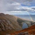 Rainbow over Lincoln Lake.- Mount Evans + Mount Goliath