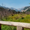The trail begins by crossing the Big Thompson River with great views to the west.- The Pool + Cub Lake Loop Hike