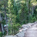 Many stone steps on this well-constructed trail.- Ouzel Falls Hike