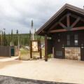 Vault toilet facility at Pawnee Campground Elk Loop.- Pawnee Campground
