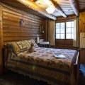 Typical queen bedroom at Allenspark Lodge.- Allenspark Lodge Bed + Breakfast