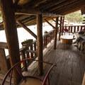Allenspark Lodge porch.- Allenspark Lodge Bed + Breakfast