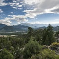 Panoramic view of Estes Park area and Rocky Mountain National Park peaks.- Gem Lake Hike via Lumpy Ridge Trailhead