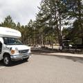 Park shuttle pickup at Glacier Basin Campground.- Glacier Basin Campground